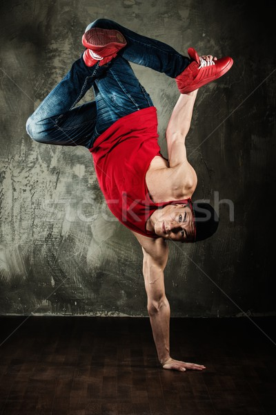 Man dancer showing break-dancing moves Stock photo © Nejron