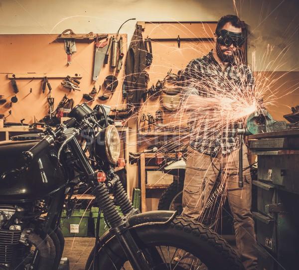 механиком мотоцикл Таможня гаража человека краской Сток-фото © Nejron