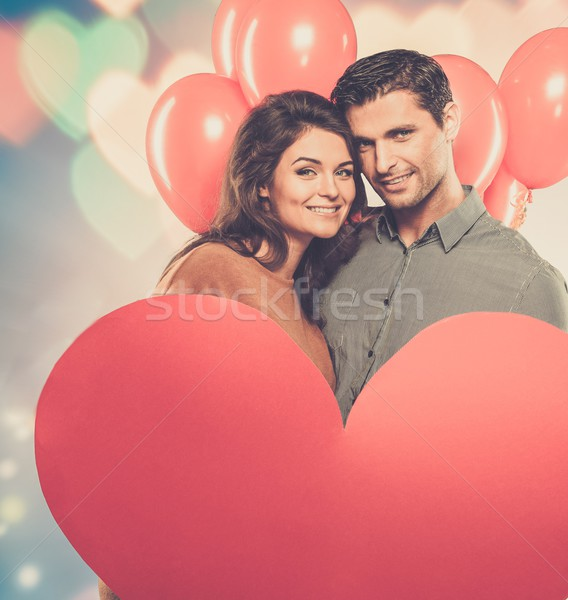Couple holding handmade paper heart and red balloons  Stock photo © Nejron