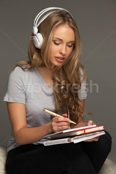 Młoda kobieta student notebooka muzyki książki twarz Zdjęcia stock © Nejron