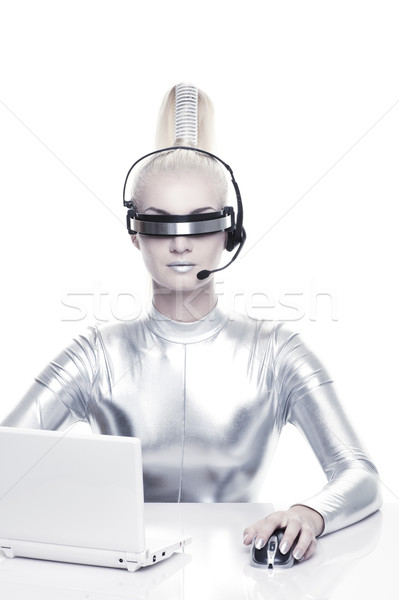 Beautiful cyber woman working on her laprop 