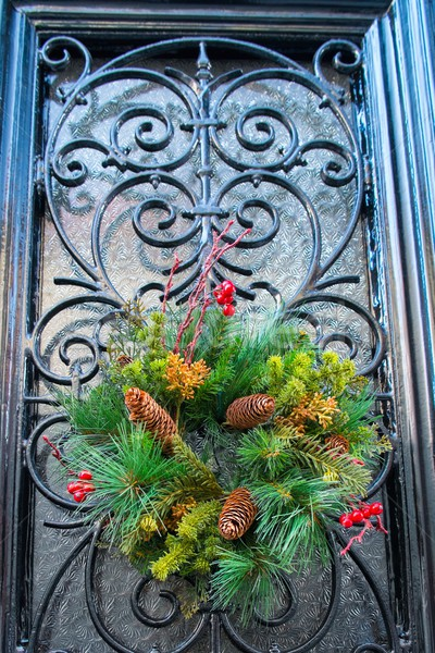 Christmas wreath with cones hanging on a door Stock photo © Nejron
