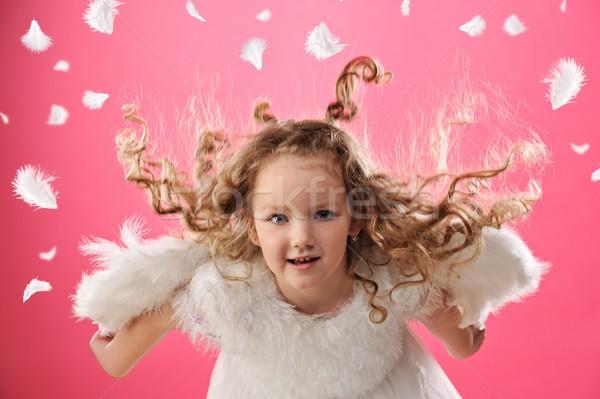 Gyönyörű kicsi angyal lány arc gyermek Stock fotó © Nejron