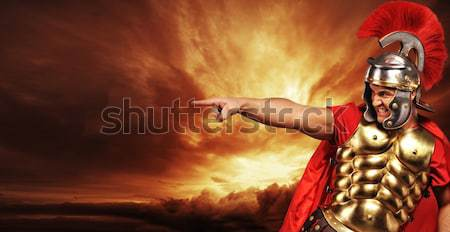 Legionary soldier over stormy sky Stock photo © Nejron