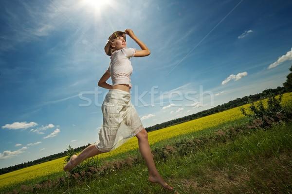 Beautiful woman in cowboy hat jumping Stock photo © Nejron