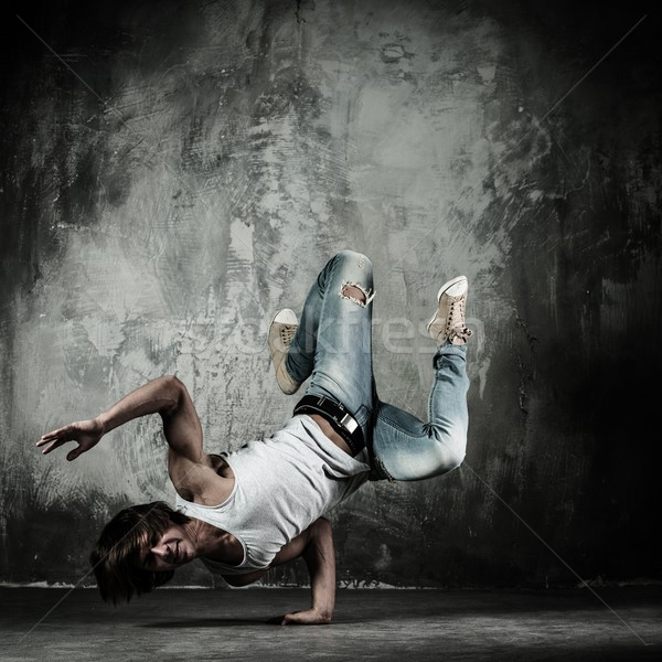 Young b-boy man doing brake dancing movements  Stock photo © Nejron