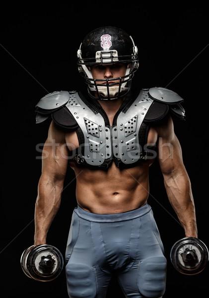 Amerikai futballista súlyzók visel sisak páncél Stock fotó © Nejron