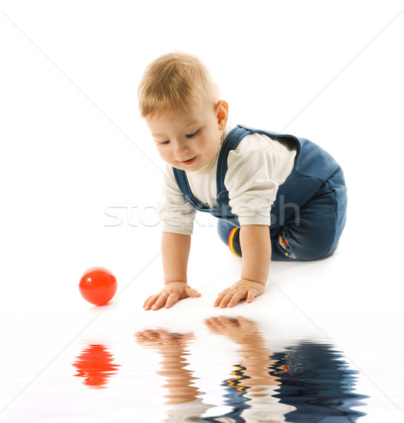 Adorable baby looking at his reflection in water Stock photo © Nejron