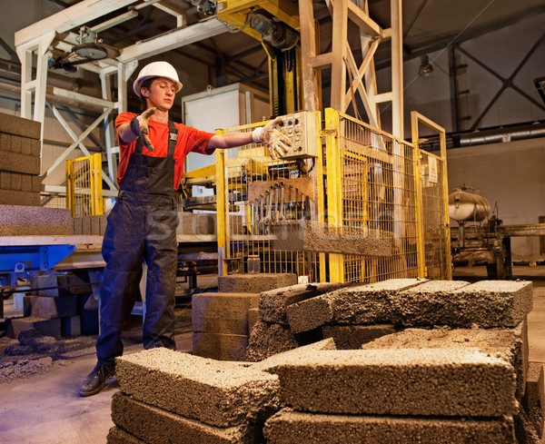 Factory worker throwing defective block Stock photo © Nejron