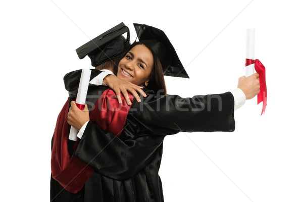 Happy graduated young students girls hugging  Stock photo © Nejron