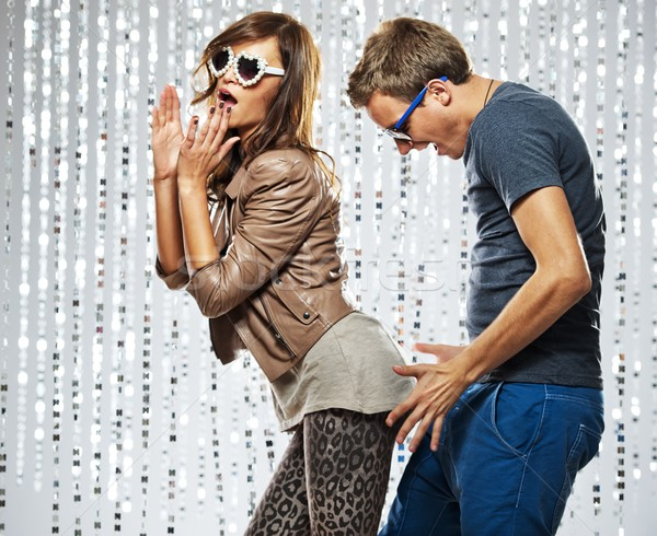 Young stylish couple flirting in the nightclub Stock photo © Nejron