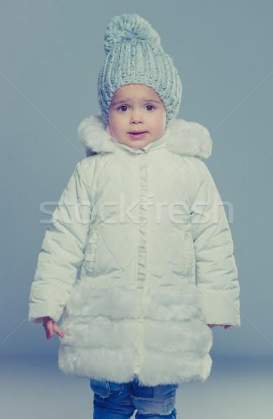 Funny little girl in winter coat Stock photo © Nejron