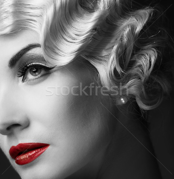 Monochrome portrait of elegant blond retro woman   with beautiful hairdo and red lipstick Stock photo © Nejron