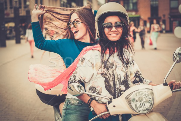 Többnemzetiségű lányok moped európai város lány Stock fotó © Nejron