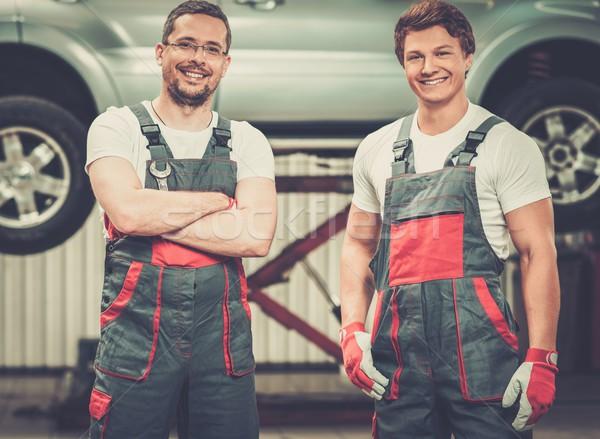 Two servicemen in a car workshop Stock photo © Nejron
