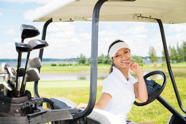 Młodych wesoły kobieta jazdy golf koszyka Zdjęcia stock © Nejron