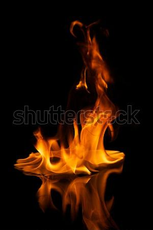 Beautiful stylish fire flames reflected in water Stock photo © Nejron