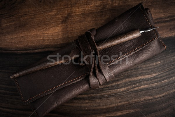 Quill pen with leather case on wooden background  Stock photo © Nejron