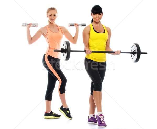 Two beautiful sporty girls doing fitness exercises  Stock photo © Nejron