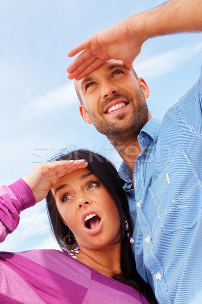 Happy smiling middle-aged couple looking at something outdoors Stock photo © Nejron