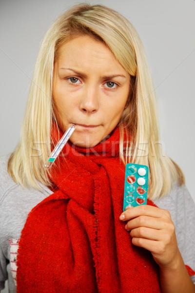 Hasta genç sarışın kadın hapları termometre Stok fotoğraf © Nejron