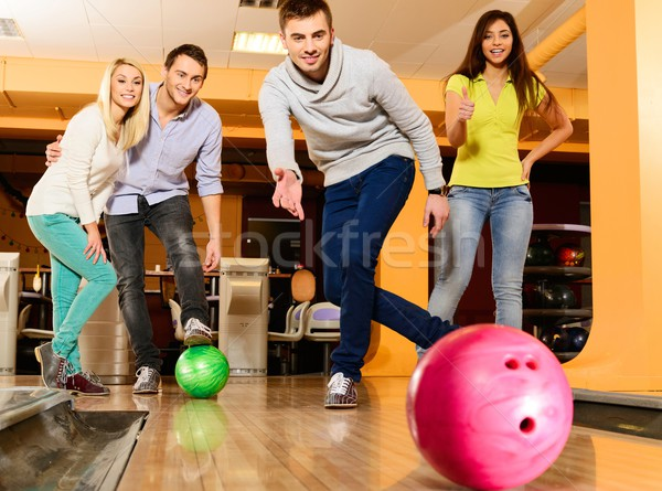 Group of four young smiling people playing bowling  Stock photo © Nejron