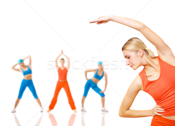 Group of women doing fitness exercise isolated on white. Lots of Stock photo © Nejron