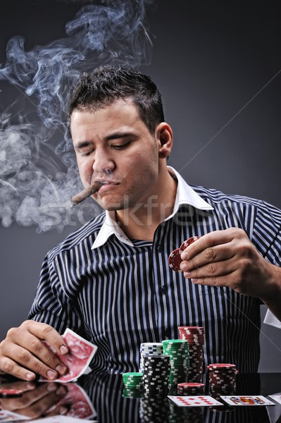 Portrait of a young gangster smoking and playing poker Stock photo © Nejron