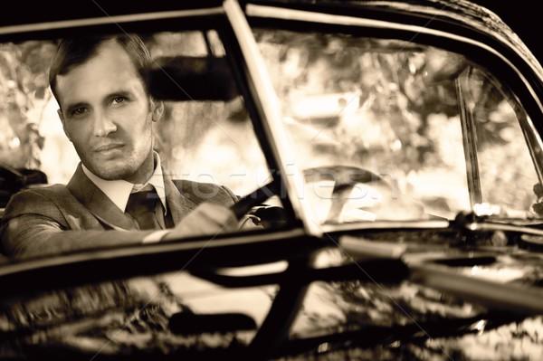 Retro man achter stuur auto mode Stockfoto © Nejron