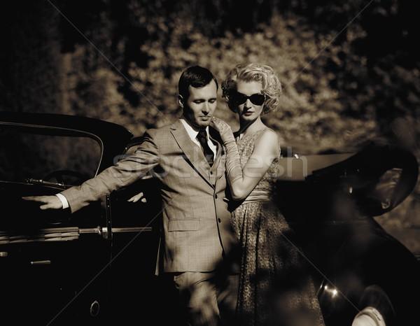 Couple near a retro car outdoors Stock photo © Nejron