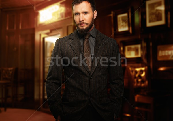 Handsome well-dressed man with beard in jacket and tie Stock photo © Nejron