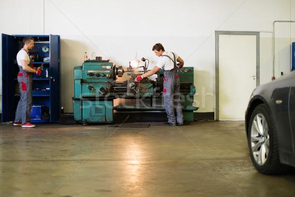 Serviceman working on turning lathe in car workshop Stock photo © Nejron