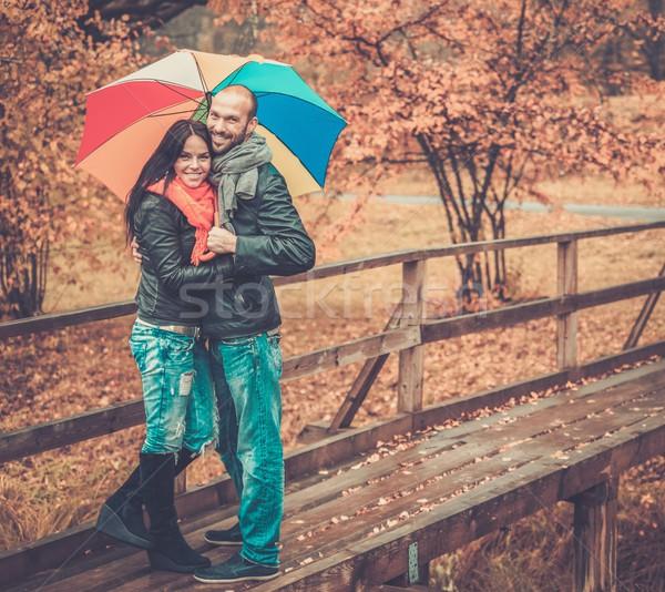 Gelukkig paar paraplu buitenshuis mooie Stockfoto © Nejron