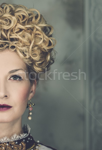 Portrait  of beautiful haughty queen in royal dress with earrings  Stock photo © Nejron