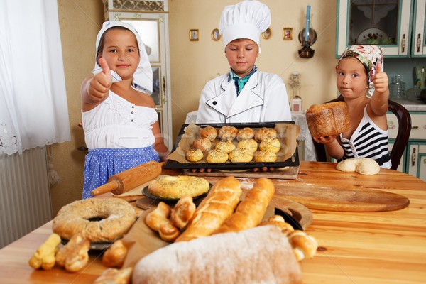 Happy children with table full of  homemade pastry Stock photo © Nejron