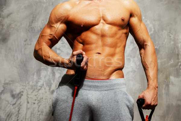 Bel homme corps musclé fitness exercice gymnase muscle Photo stock © Nejron