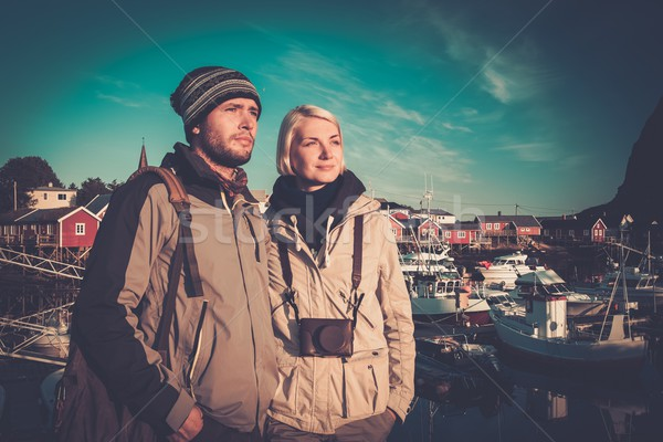 Young travellers couple in Reine village, Norway Stock photo © Nejron