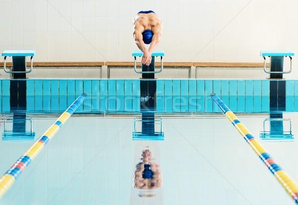 молодые мышечный пловец прыжки Бассейн человека Сток-фото © Nejron