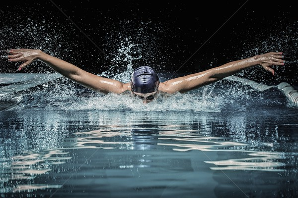 Young man in swimming cap and goggles swim using breaststroke technique  Stock photo © Nejron