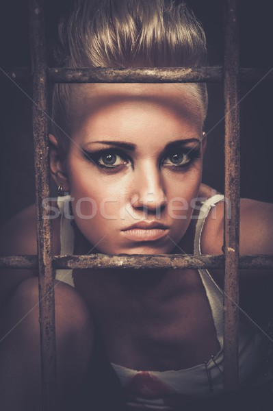 Troubled teenager girl behind bars Stock photo © Nejron