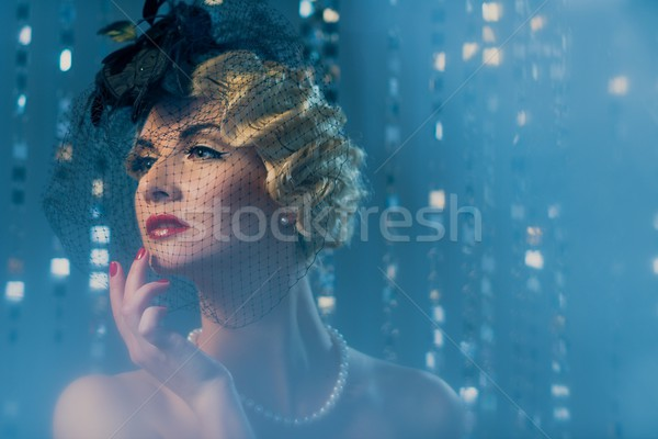 Elegant blond retro woman with beautiful hairdo and red lipstick wearing hat with veil Stock photo © Nejron