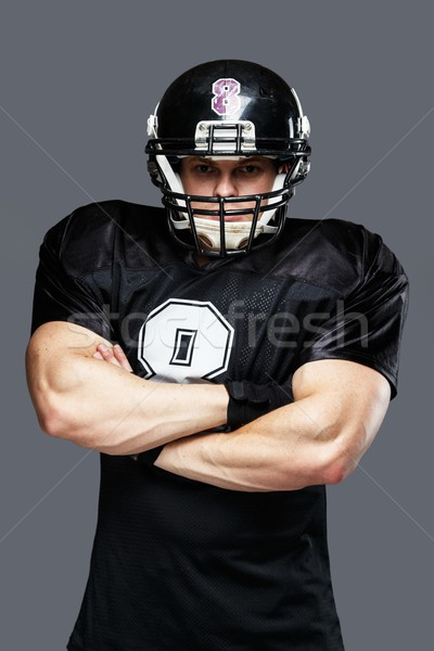 American football player wearing helmet and black jersey with number Stock photo © Nejron