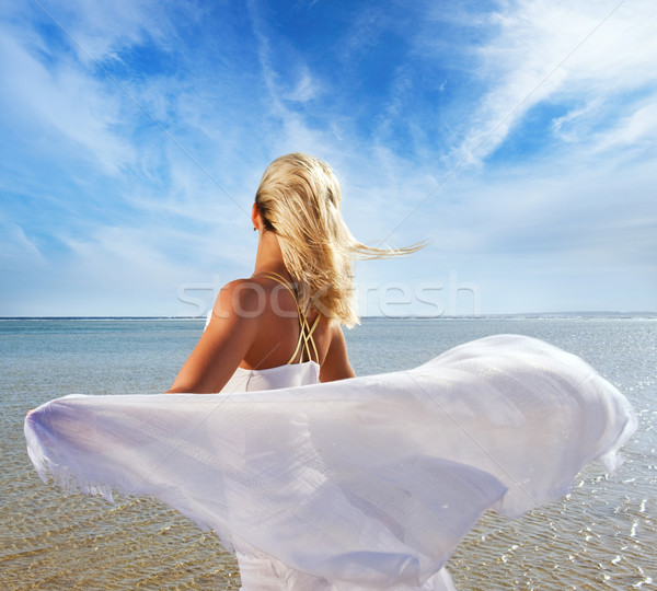Blond woman with white shawl relaxing near the sea Stock photo © Nejron