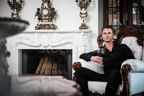 Handsome well-dressed man sitting with red wine in luxury  house interior  Stock photo © Nejron