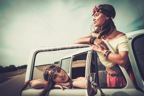 Hippie girls in a minivan on a road trip Stock photo © Nejron