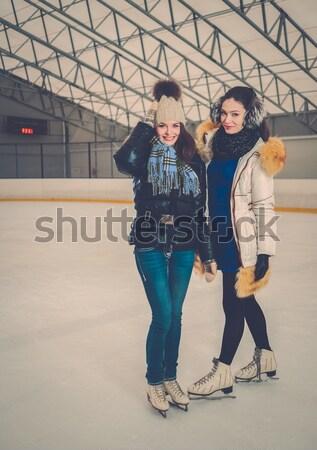 Two girls on ice-skating rink  Stock photo © Nejron