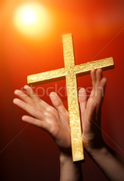 Golden cross in human hands Stock photo © Nejron