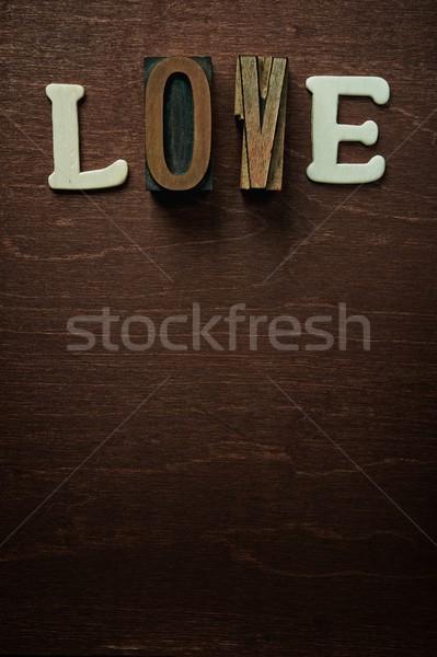 The word love written on wooden background Stock photo © Nejron
