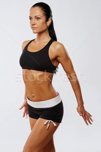 Beautiful athlete woman doing fitness exercise. Stock photo © Nejron