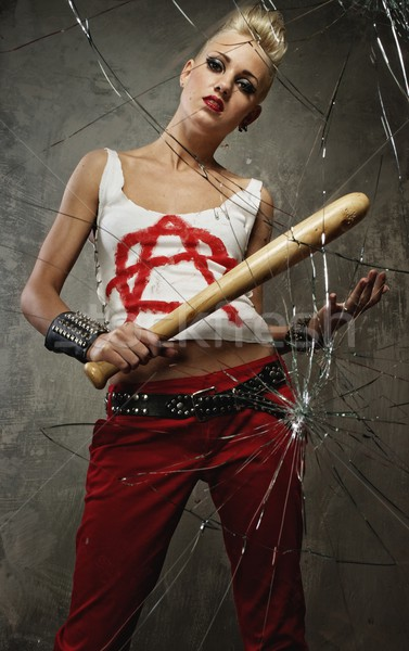 Punk girl with a bat behind broken glass Stock photo © Nejron